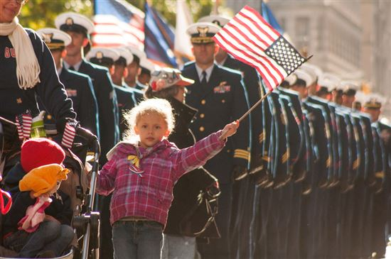 US Coast Guard families and service members march in New York City's Veterans Day Parade [Image 4 of